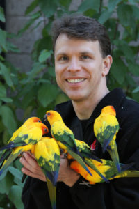 Dr Echols with sun conures